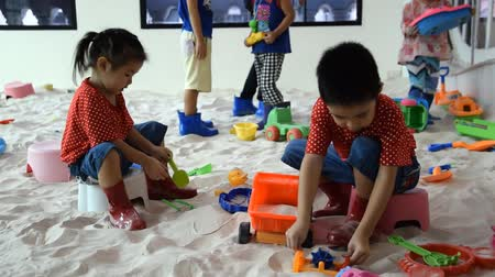 BANGKOK THAILAND-June 21: Child playing toys in sand, on June 21,2015 in Thailand Wideo