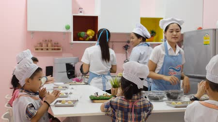 BANGKOK THAILAND-July 19:  Woman with child teaching her to cook. Students child Cooking Class, on October 19,2016 in Thailand