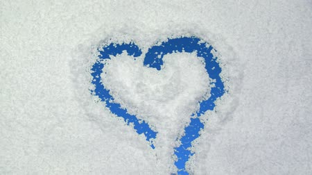 fosco : Heart drawn on snow background with matte