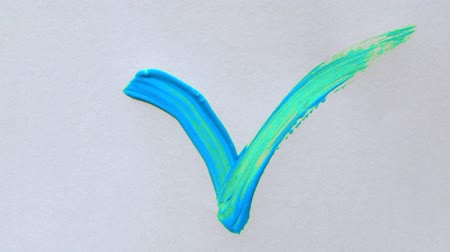 stroke : Paintbrush painting a color check mark symbol on white paper