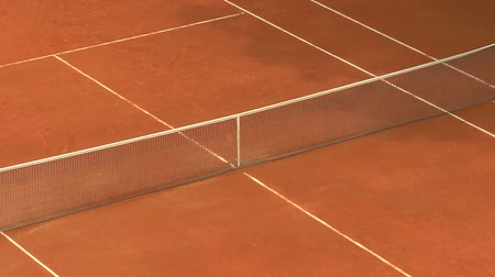 tennis game : Balls bouncing on orange clay tennis court