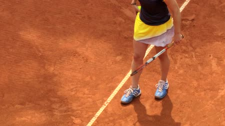tennis game : Detail of a players feet during serve motion in a clay court