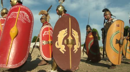 "legionary : AQUILEIA - JUNE 22: Roman legionaries marching during the reenactment ""Tempora Aquileia"" on June 22, 2013 in Aquileia, Italy"