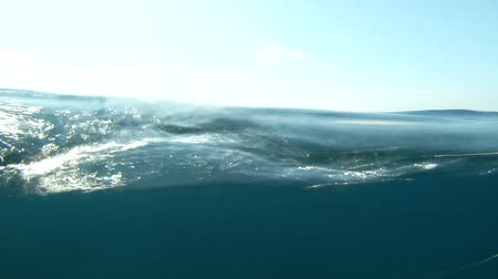 su üzerinde ufuk : Sea water surface with blue sky splitted by waterline to underwater part with air bubbles