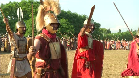 legionary : AQUILEIA - JUNE 23: Reenactment of roman legion marching against gaulish army during the battle of Aquileia (180 BC) on June 23, 2013 in Aquileia, Italy Stock Footage