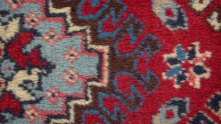 çini : Close up of persian carpet, horizontal tracking