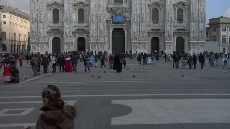 europe population : Time lapse of tourist on Piazza Duomo on February 2013 in Milan, Italy.