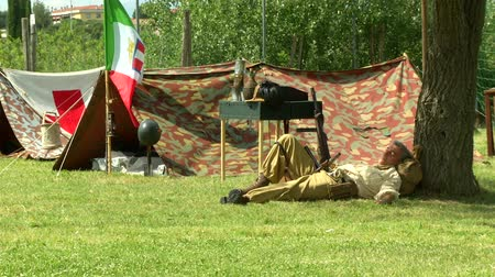 csatatér : Italian soldiers at command post during a WWII reenactment on 18 may 2014 in Signa, Italy Stock mozgókép