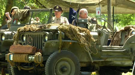 csatatér : US soldiers on jeep at command post during a WWII reenactment on 18 may 2014 in Signa, Italy