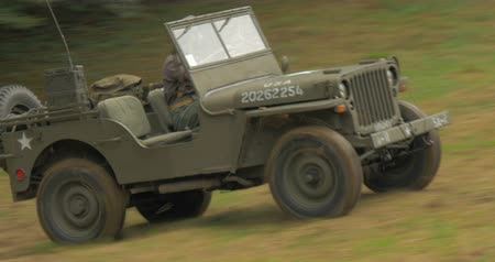 csatatér : US soldiers on jeep at command post during a WWII reenactment on 20 September 2014 at Passo del Giogo, Italy