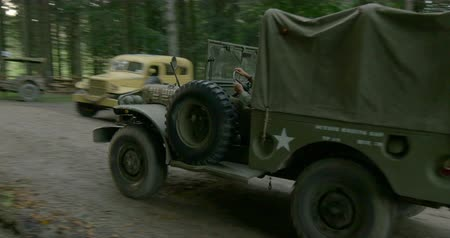 csatatér : US military vehicles at command post during a WWII reenactment on 20 September 2014 at Passo del Giogo, Italy Stock mozgókép