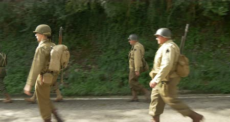 csatatér : US soldiers on the march during a WWII reenactment on 20 September 2014 in San Quirico, Italy