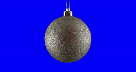 srebro : Silver Christmas ball isolated on blue screen background, rotating loop