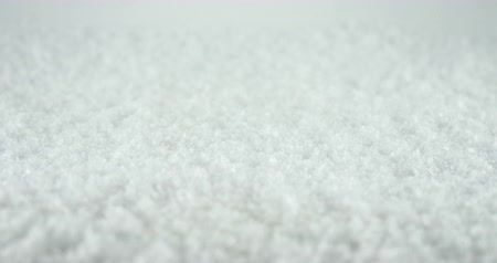 иней : Close up of falling snowflakes on snow background Стоковые видеозаписи