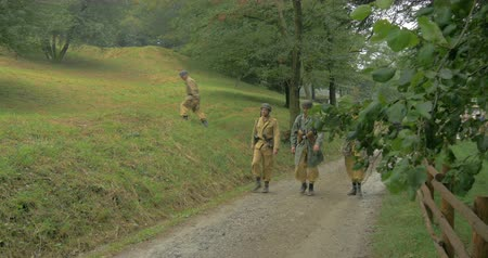 csatatér : German soldiers from a mountain unit during a WWII reenactment on 20 September 2014 at Monte Altuzzo, Italy Stock mozgókép