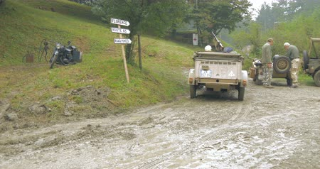 csatatér : German military vehicles on mountain road during a WWII reenactment on 21 September 2014 at Passo del Giogo, Italy