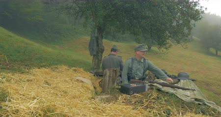 csatatér : Two german soldiers in a fox-hole along the Gothic Line Defense during a WWII reenactment on 21 September 2014 at Monte Altuzzo, Italy