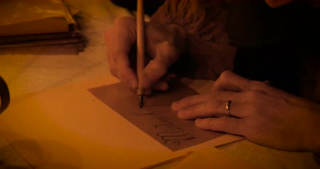 рукопись : Close up of scribes hands while writing a letter with a plume Dogliani Italy on December 23 2014. Стоковые видеозаписи