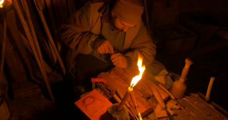grawerowanie : A wood carver illuminated by candlelight at Villongo Italy on January 6 2015