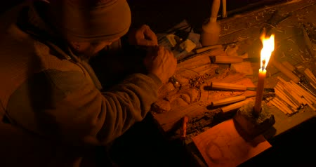 grawerowanie : A wood carver illuminated by candlelight at Villongo Italy on January 6 2018 Wideo