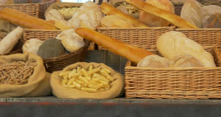 bakery : Bread and pasta on wooden shelf of a bakery