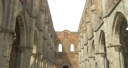 roofless : The colonnade of the roofless Cistercian abbey of San Galgano Abbey in Tuscany, August 2015, Italy