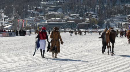 horserace : The European Championship of horserace on the White Turf in the magnificent scenery of the Upper Engadine on February 23rd, 2014 in St. Moritz Switzerland Stock Footage