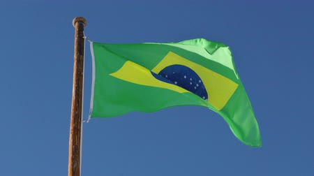 brasil : Brazil flag in slow motion on blue sky