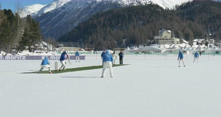 wicket : A cricket bowler delivers a fast bowl in a cricket match during Cricket on Ice in St. Moritz (Switzerland) on 18th February 2016 Stock Footage