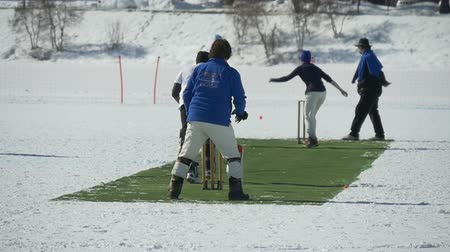 wicket : A cricket bowler delivers a fast bowl in a cricket match during Cricket on Ice in St. Moritz (Switzerland) on 18th February 2016 - slow motion
