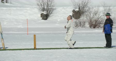 подача : A cricket batsman making a run in a cricket match during Cricket on Ice in St. Moritz (Switzerland) on 18th February 2016 Стоковые видеозаписи