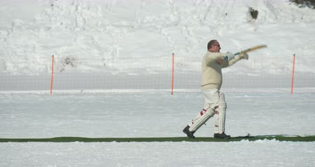 wicket : A cricket batsman making a run in a cricket match during Cricket on Ice in St. Moritz (Switzerland) on 18th February 2016 Stock Footage