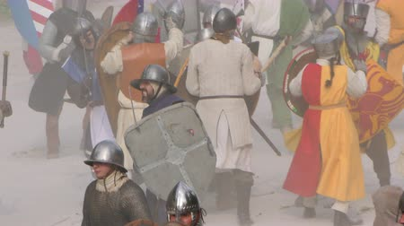kuşatma : Knights battle on the field during the reenactment of the Siege of the Castle of Brescia (1238 AD), Brescia (Italy) on 7 June 2015. Stok Video