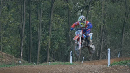 enduro : A motocross rider jumps in slow-motion