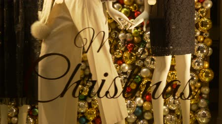 "milan fashion : Merry Christmas"" written on a storefront of a fashion shop Stock Footage"