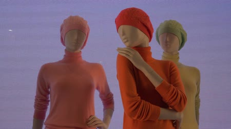 milan fashion : Colorful female mannequins on a noise video background