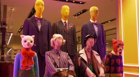 milan fashion : A puppet rag doll family mannequins inside a fashion house showcase
