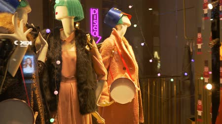 milan fashion : Toy female mannequins and  big toy soldiers in a fashion shop showcase Stock Footage