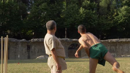 javelin : An ancient roman pentathlon athlete throwing discus in slow motion during the reenactment 'Back In Time' on July 29, 2017 in Arezzo (Italy)