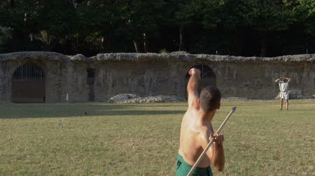 javelin : An ancient roman pentathlon athlete throwing javelin in slow motion during the reenactment 'Back In Time' on July 29, 2017 in Arezzo (Italy)