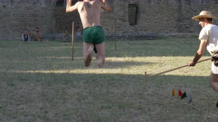 javelin : An ancient roman pentathlon athlete jumping in slow motion during the reenactment 'Back In Time' on July 29, 2017 in Arezzo (Italy)