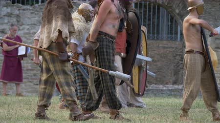 conquest : Battle between Gaulish warriors and Roman legionaries during the reenactment 'Back In Time' on July 29, 2017 in Arezzo (Italy)