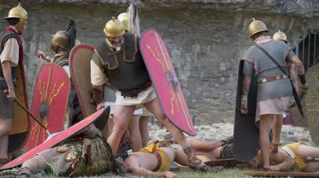 legionary : Battle between Gaulish warriors and Roman legionaries during the reenactment 'Back In Time' on July 29, 2017 in Arezzo (Italy)