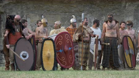 silahlar : Gaulish warriors in the Roman Gallic war during the reenactment 'Back In Time' on July 29, 2017 in Arezzo (Italy) Stok Video