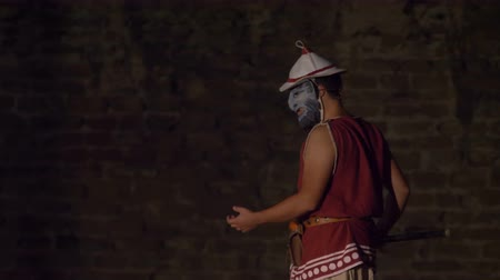 victor : The 'Charun', an official who accompanied the dead from the Roman gladiatorial arena, during the reenactment 'Back In Time' on July 29, 2017 in Arezzo (Italy)