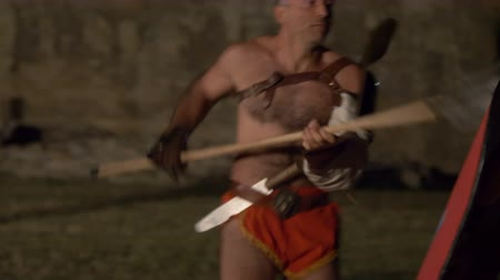 victor : Two roman gladiators (Secutor against Retiarius) combat during the reenactment 'Back In Time' on July 29, 2017 in Arezzo (Italy)