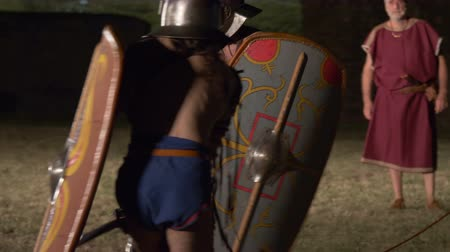victor : Two roman gladiators (Thraex against Thraex) combat during the reenactment 'Back In Time' on July 29, 2017 in Arezzo (Italy) Stock Footage