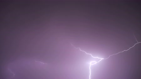 electric strike : Lightning strike and bolt isolated on black background Stock Footage