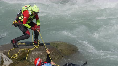 jangada : A boy is rescued while rafting down the Dora Baltea river during World Rafting Championship on 23 July 2018, Ivrea (Italy)