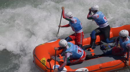 bolgár : The Bulgarian Under 23 men's rafting team in the training on the Dora Baltea river during World Rafting Championship on 23 July 2018, Ivrea (Italy) Stock mozgókép